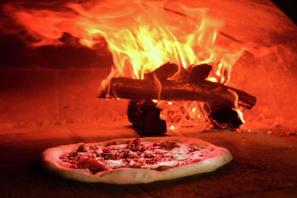 The Spicy Italian Fennel Sausage Pizza is cooked in a wood fire oven at the Stella Public House in the Blue Star Arts Complex.