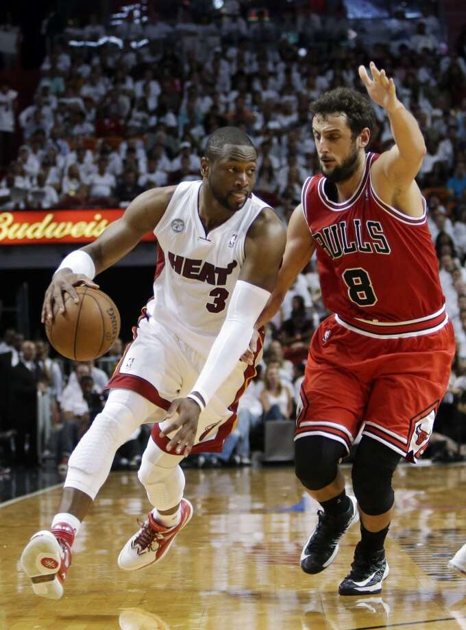 Miami Heat guard Dwyane Wade (3) drives against Chicago Bulls guard Marco Belinelli (8) of Italy, during the first half of Game 1 of the NBA basketball playoff series in the Eastern Conference semifinals, Monday, May 6, 2013 in Miami.