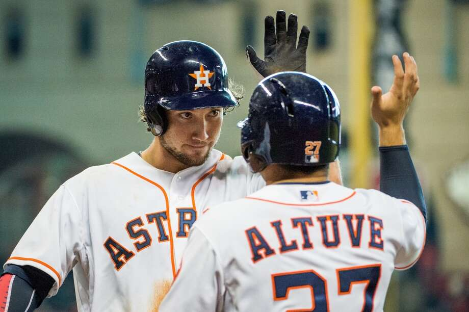 Astros third baseman Brett Wallace celebrates with Jose Altuve after hitting a three-run home run during the eighth inning. The homer tied the game at 5-5.