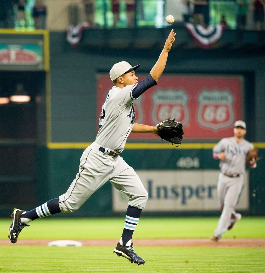 Rays starting pitcher Chris Archer flips the ball to first to get the out on Astros center fielder Brandon Barnes during the third inning.