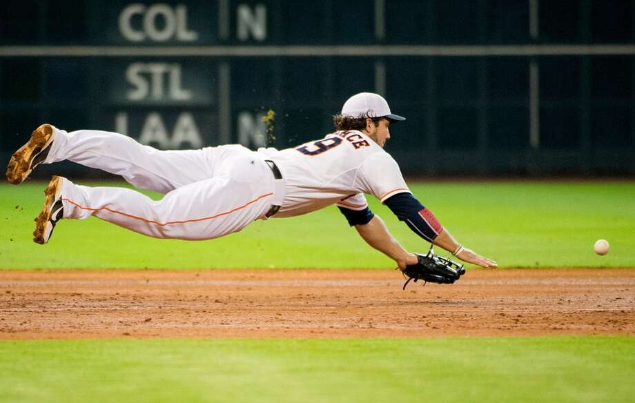 Astros third baseman Brett Wallace dives for a single by Rays shortstop Yunel Escobar during the fifth inning.
