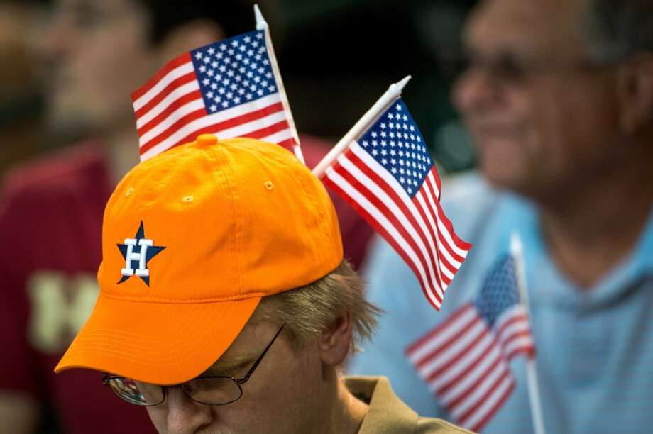 A fan sports two American flags in his hat.