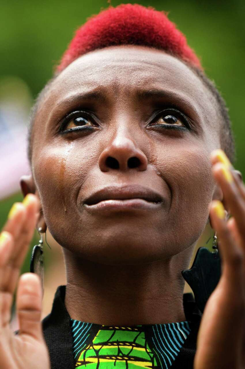 Kenyan candidate Naomi Wachira weeps while being sworn in as a U.S. citizen at the 29th Annual Naturalization Ceremony Thursday, July 4, 2013, in the Seattle Center Fisher Pavilion in Seattle. The event, hosted by the Ethnic Heritage Council, brought 490 candidates from 87 countries and nations to swear in as U.S. citizens.