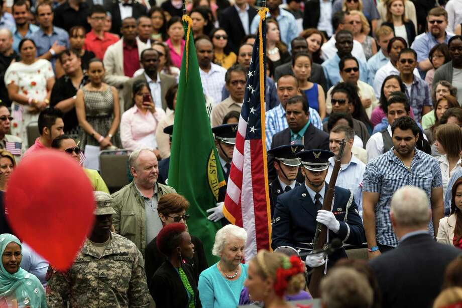 The United States Army Color Guard marches toward the stage to present the colors at the 29th Annual Naturalization Ceremony Thursday, July 4, 2013, in the Seattle Center Fisher Pavilion in Seattle. The event, hosted by the Ethnic Heritage Council, brought 490 candidates from 87 countries and nations to swear in as U.S. citizens. Photo: JORDAN STEAD, SEATTLEPI.COM / SEATTLEPI.COM