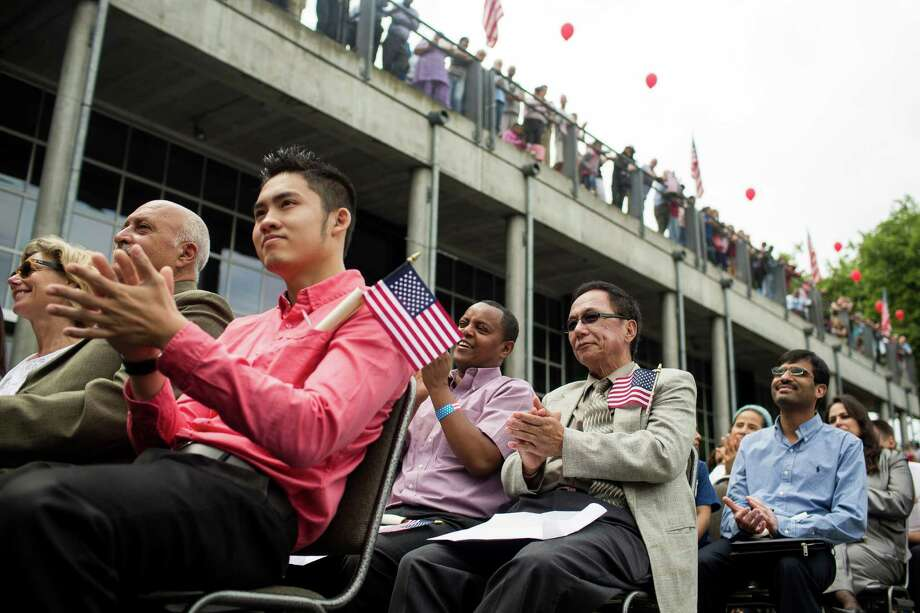 Candidates listen to keynote speakers at the 29th Annual Naturalization Ceremony Thursday, July 4, 2013, in the Seattle Center Fisher Pavilion in Seattle. The event, hosted by the Ethnic Heritage Council, brought 490 candidates from 87 countries and nations to swear in as U.S. citizens. Photo: JORDAN STEAD, SEATTLEPI.COM / SEATTLEPI.COM