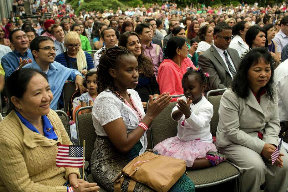 Candidates from 87 different countries rejoice after being sworn in at the 29th Annual Naturalization Ceremony Thursday, July 4, 2013, in the Seattle Center Fisher Pavilion in Seattle. The event, hosted by the Ethnic Heritage Council, brought 490 candidates. Photo: JORDAN STEAD, SEATTLEPI.COM / SEATTLEPI.COM