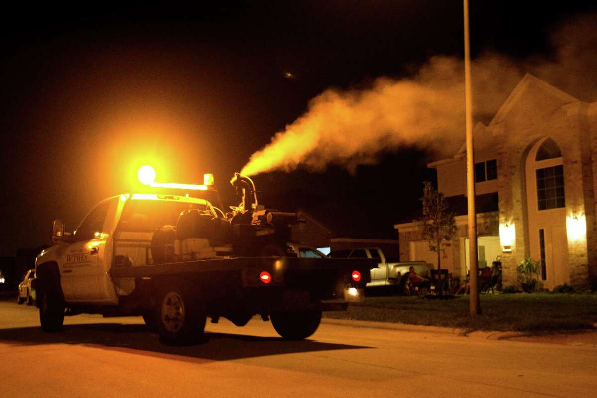 A truck sprays pesticide in a North Dallas neighborhood in 2013, trying to quell the spread of West Nile Virus by mosquitoes. Now attention has turned from West Nile to Zika as local cases mount and mosquito season approaches.