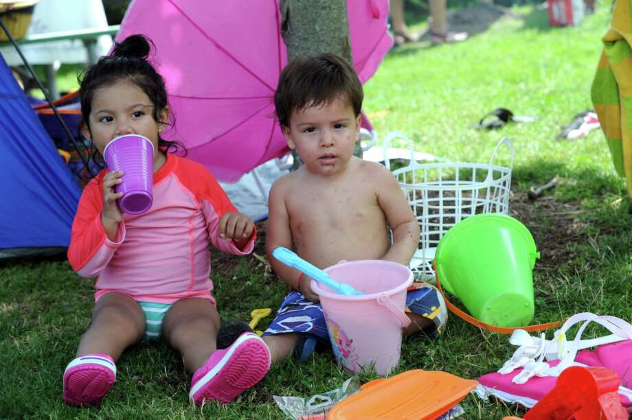 Jade Serpa, 2-years-old and Sebastian Caband, 1-year-old, play with a buckets enjoying the holiday at Byram Park, in Byram, Thursday, July 4, 2013. Photo: Helen Neafsey / Greenwich Time