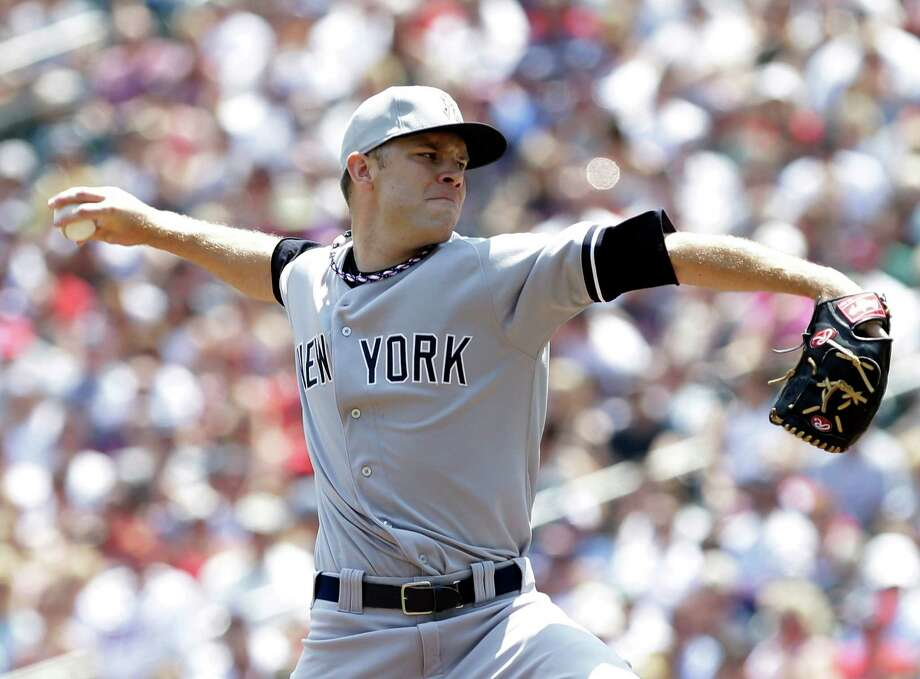 New York Yankees pitcher David Phelps throws against the Minnesota Twins in the first inning of a baseball game, Thursday, July 4, 2013 in Minneapolis. (AP Photo/Jim Mone) ORG XMIT: MNJM102 Photo: Jim Mone / AP