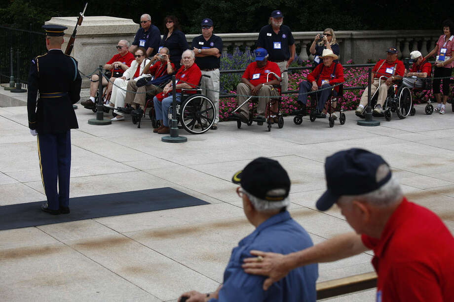 Alamo Honor Flight participants watch the changing of the guard at the Tomb of the Unknowns at Arlington in 2010. Photo: Lisa Krantz / San Antonio Express-News