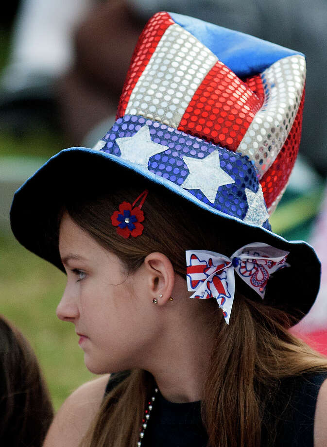Abby Lobue,11, wears a patriotic hat during the Freedom Over Texas festival at Eleanor Tinsley Park on Thursday, July 4, 2013, in Houston. Photo: J. Patric Schneider, For The Chronicle / © 2013 Houston Chronicle