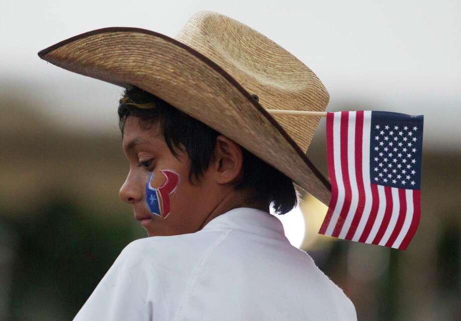 A youngster wears an American Flag in his cowboy hat during the Freedom Over Texas festival at Eleanor Tinsley Park on Thursday, July 4, 2013, in Houston. Photo: J. Patric Schneider, For The Chronicle / © 2013 Houston Chronicle