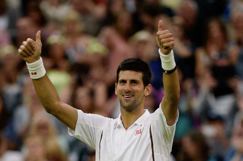 LONDON, ENGLAND - JUNE 27:  Novak Djokovic of Serbia celebrates match point during his Gentlemen's Singles second round match against Bobby Reynolds of the United States of America on day four of the Wimbledon Lawn Tennis Championships at the All England Lawn Tennis and Croquet Club on June 27, 2013 in London, England.  (Photo by Dennis Grombkowski/Getty Images) Photo: Dennis Grombkowski, Staff / 2013 Getty Images