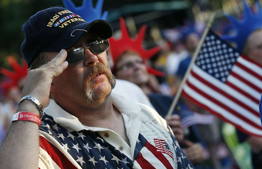 Al Mitchell, of Barnstead, N.H., salutes during the national anthem before the Boston Pops Fourth of July Concert at the Hatch Shell in Boston, Thursday, July 4, 2013. Photo: Michael Dwyer, Associated Press