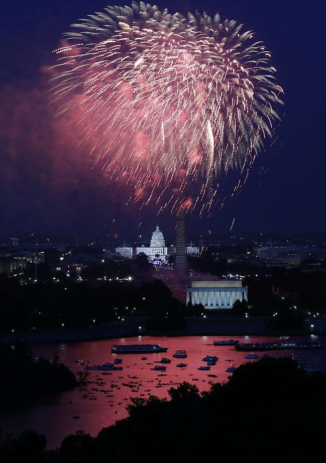 Fireworks light the sky over the U.S. Capitol, left, the Washington Monument and the Lincoln Memorial during Fourth of July celebrations, Thursday, July 4, 2013 in Washington. Surrounded by scaffolding, the Washington Monument is closed for repairs after an earthquake in 2011. (AP Photo/Alex Brandon) Photo: Alex Brandon, Associated Press