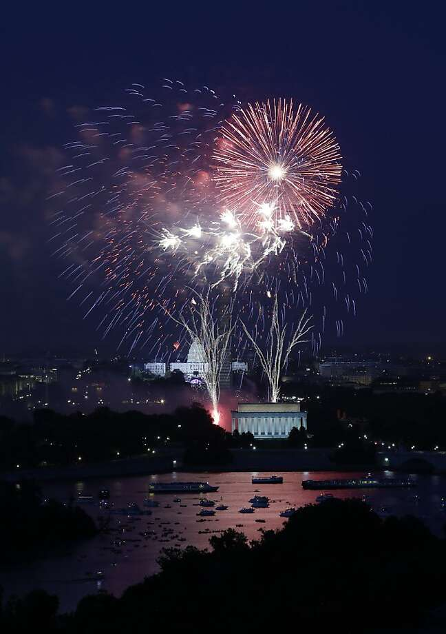 Fireworks light the sky over the U.S. Capitol, left, the Washington Monument and the Lincoln Memorial during Fourth of July celebrations, Thursday, July 4, 2013 in Washington. Surrounded by scaffolding, the Washington Monument is closed for repairs after an earthquake in 2011. Photo: Alex Brandon, Associated Press