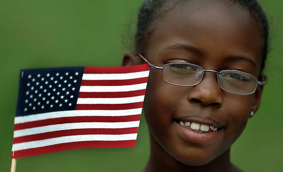 Ayana Townsend-Barnes, 8, of Scranton, Pa. displays her patriotic pride with her American Flag on Thursday, July 4, 2013 during the annual Honor The Flag Ceremonies held at Nay Aug Park in Scranton, Pennsylvania.  (AP Photo / The Scranton Times-Tribune, Butch Comegys)  WILKES BARRE TIMES-LEADER OUT; MANDATORY CREDIT Photo: Butch Comegys, Associated Press