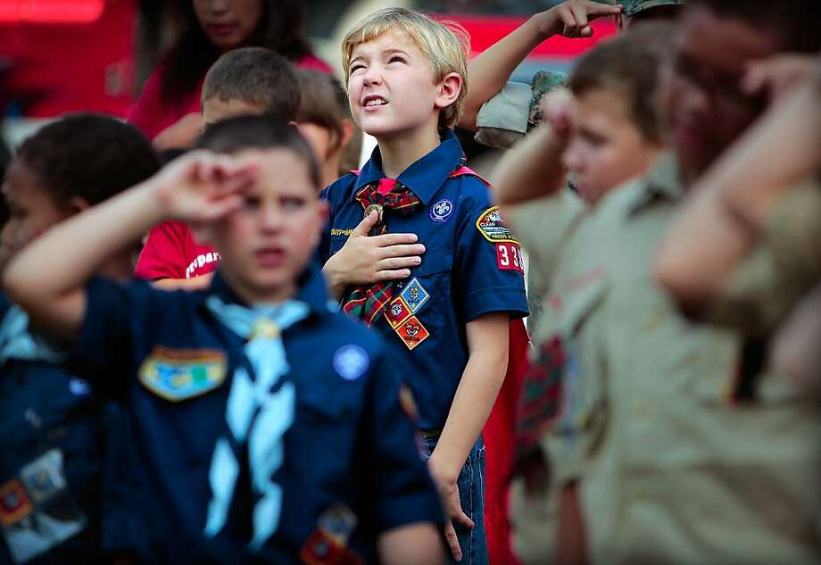 Cub Scout Tristan Jenkins, 9, says the Pledge of Allegiance during a flag ceremony before the start of  the Cordova Independence Day Parade Thursday morning at the Cordova Community Center in Cordova, Tenn. Thursday, July 4, 2013.  (AP Photo/The Commercial Appeal, Jim Weber) Photo: Jim Weber, Associated Press