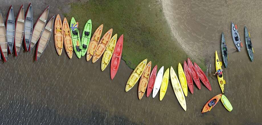 A kayaks line the shore of Lake Jean at Ricketts Glen State Park, Red Rock, Pa., on Thursday, July 4, 2013. (AP Photo/Bloomsburg Press Enterprise, Jimmy May) Photo: Jimmy May, Associated Press