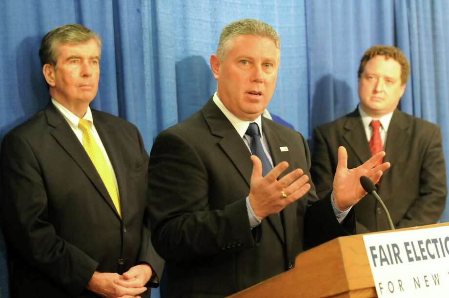 Assemblyman-elect John McDonald, center, speaks about fair elections during a news conference on Tuesday, Dec. 11, 2012, at the Legislative Office Building in Albany, N.Y. (Cindy Schultz / Times Union) Photo: Cindy Schultz / 00020431A