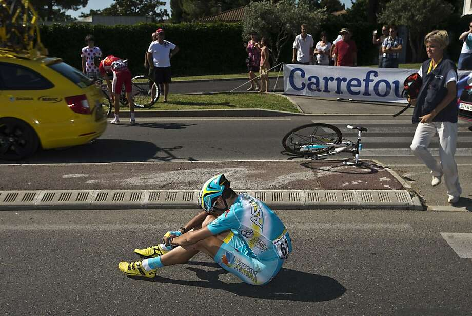TOPSHOTS Slovakia's Janez Brajkovic sits on the ground after falling during the 176.5 km sixth stage of the 100th edition of the Tour de France cycling race on July 4, 2013 between Aix-en-Provence and Montpellier, southern France.  TOPSHOTS/AFP PHOTO / JOEL SAGETJOEL SAGET/AFP/Getty Images Photo: Joel Saget, AFP/Getty Images