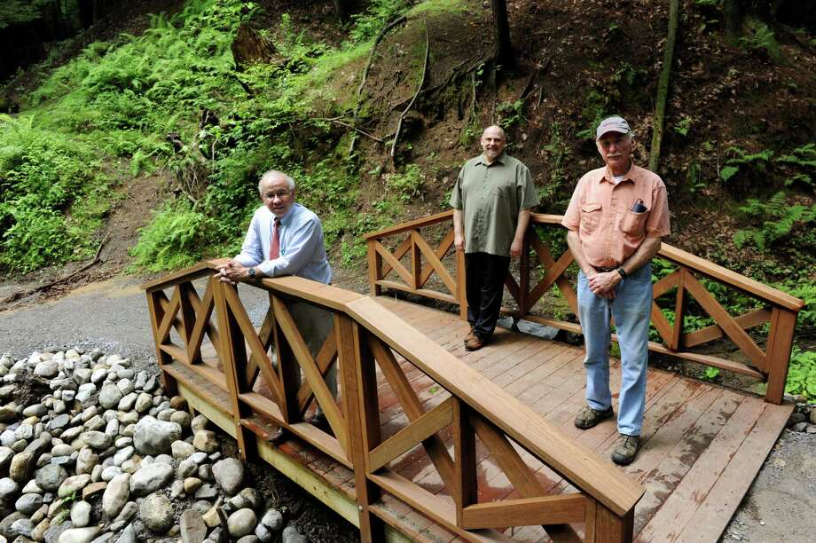 Dan Blanchfield, left, Phil Henzel, center, and Don Nichols, all Friends of Saratoga Spa State Park, stand on a rebuilt bridge on the Ferndell Trail on Wednesday, July 3, 2013, at Saratoga Spa State Park in Saratoga Springs, N.Y. (Cindy Schultz / Times Union) Photo: Cindy Schultz / 00023019A
