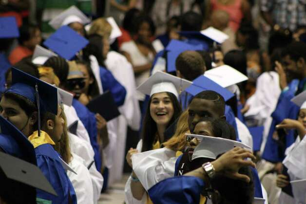 Syracuse University-bound graduate Jennifer Criscione expresses her happiness after receiving her diploma at the Albany High School graduation ceremony on June 23. (Eileen Criscione)