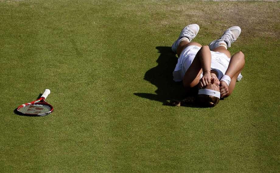 Sabine Lisicki rejoices after rallying for her 6-4, 2-6, 9-7 semifinal win over Agnieszka Radwanska in women's singles. Photo: Dennis Grombkowski / Getty Images