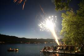 Residents and visitors of Alexander's Lake sit out on their docks and in small boats as they watch neighborhood fireworks as they celebrate Independence Day, Thursday, July 4, 2013, in Dayville, Conn. (AP Photo/Ross D. Franklin)