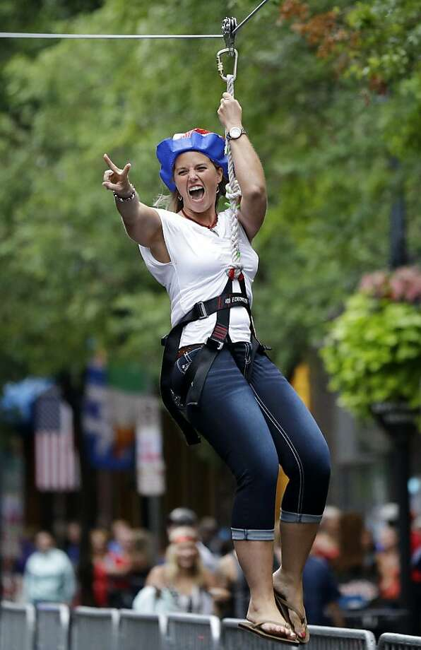 Shari Andrews, of Columbus, Ohio, rides a zip line during Independence Day activities on Thursday, July 4, 2013, in Nashville, Tenn. Photo: Mark Humphrey, Associated Press