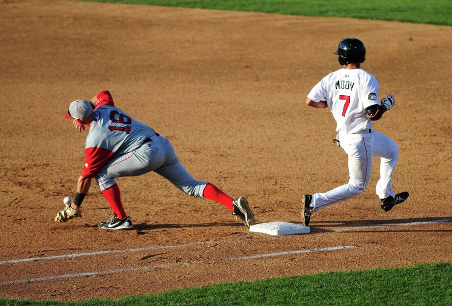 Tri-City ValleyCatsO infielder Chan Moon, right, makes it safely to first base in the third inning, after Kevin Mager of the Lowell Spinners struggled with the catch Thursday afternoon, July 4, 2013, at Joe Bruno Stadium in Troy, N.Y. (Will Waldron/Times Union) Photo: WILL WALDRON / 00023056A