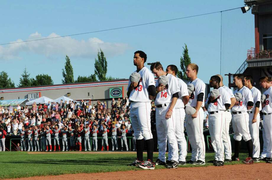 Tri-City ValleyCats team members stand for the national anthem before their game against the Lowell Spinners Thursday afternoon, July 4, 2013, at Joe Bruno Stadium in Troy, N.Y. (Will Waldron/Times Union) Photo: WILL WALDRON / 00023056A