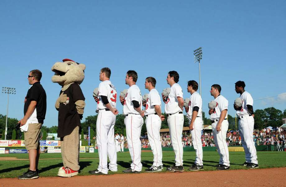 Tri-City ValleyCats members stand for the national anthem before their game against the Lowell Spinners Thursday afternoon, July 4, 2013, at Joe Bruno Stadium in Troy, N.Y. (Will Waldron/Times Union) Photo: WILL WALDRON / 00023056A