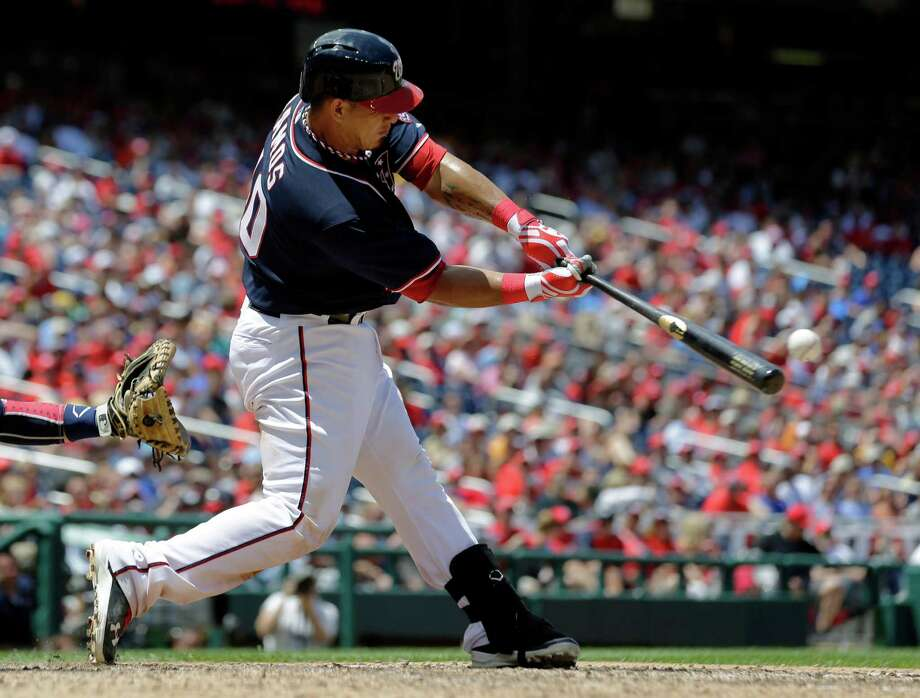 Washington Nationals' Wilson Ramos (40) hits a three-run home run during the seventh inning of a baseball game against the Milwaukee Brewers at Nationals Park Thursday, July 4, 2013, in Washington. The Nationals won 8-5. (AP Photo/Alex Brandon) ORG XMIT: NAT111 Photo: Alex Brandon / AP