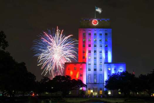 Fireworks explode over the Houston City Hall during the Southwest Airlines Freedom Over Texas, the city of Houston's official Fourth of July celebration, on Thursday, July 4, 2013, in Houston. Photo: Smiley N. Pool, Houston Chronicle / © 2013  Houston Chronicle