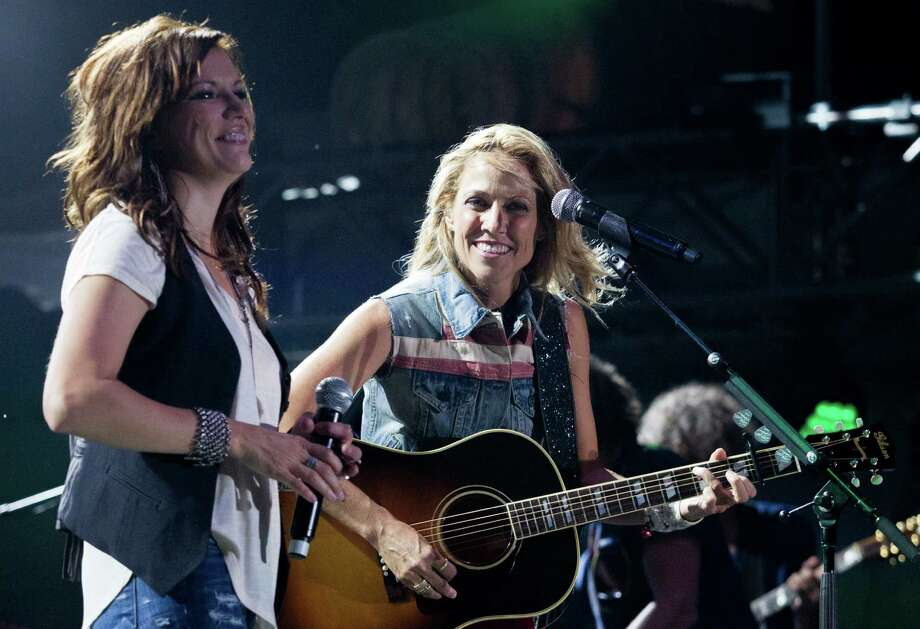 Singer-songwriters Martina Mcbride and Sheryl Crow perform during the Freedom Over Texas festival at Eleanor Tinsley Park on Thursday, July 4, 2013, in Houston. Photo: J. Patric Schneider, For The Chronicle / © 2013 Houston Chronicle
