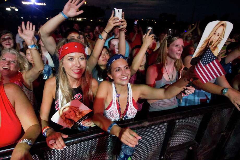 Fans cheer on singer-songwriter Sheryl Crow as she performs during the Freedom Over Texas festival at Eleanor Tinsley Park on Thursday, July 4, 2013, in Houston. Photo: J. Patric Schneider, For The Chronicle / © 2013 Houston Chronicle