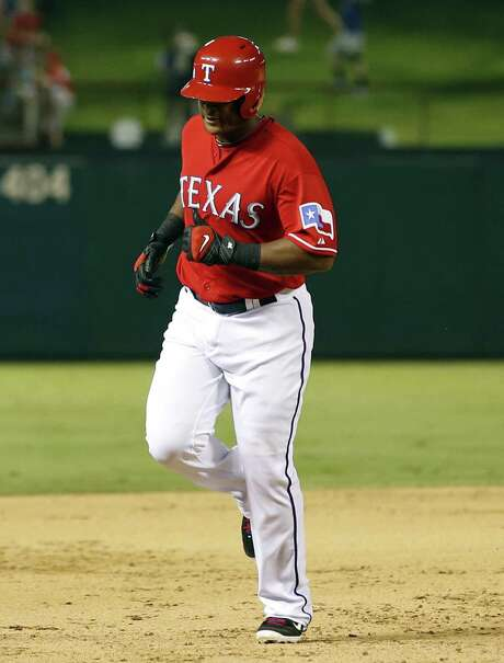 The Rangers' Adrian Beltre rounds the bases after his solo homer in the seventh inning against the Mariners. Photo: Jim Cowsert / Associated Press