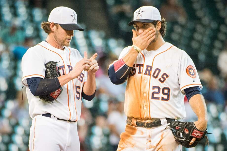 Astros relief pitcher Josh Fields (50) and third baseman Brett Wallace (29) react after a double by  Rays shortstop Yunel Escobar scored Jose Lobaton during the eleventh inning,