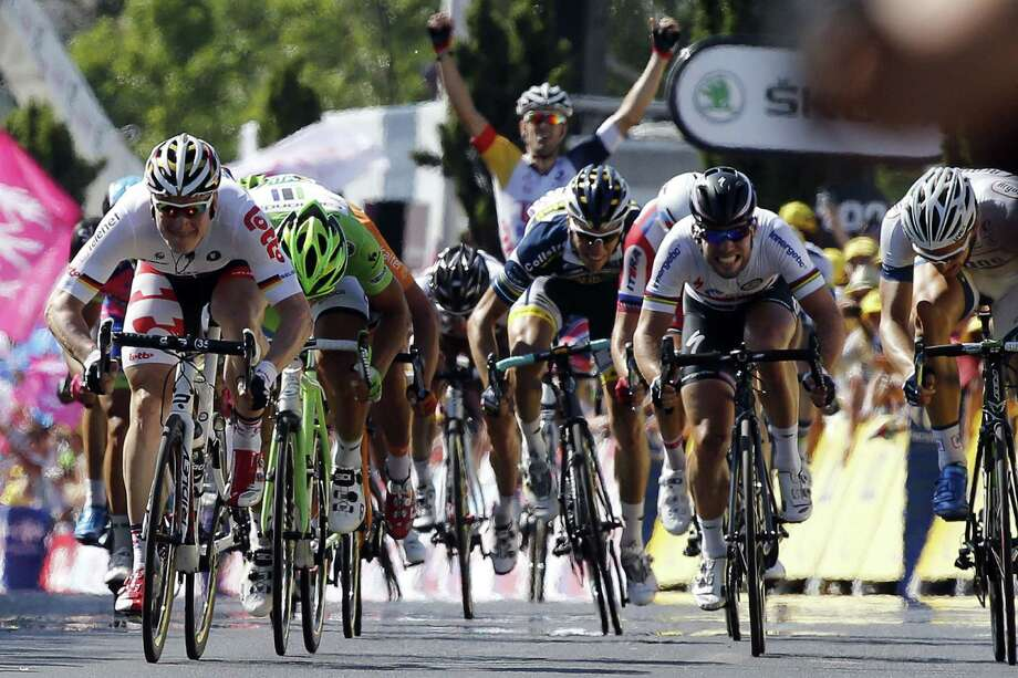Daryl Impey, left, sprints to the finish line in the Tour de France at Montpellier on Thursday, becoming the first South African to hold the overall lead. Germany's Andre Greipel won Thursday's sixth stage. Photo: PASCAL GUYOT, Staff / AFP