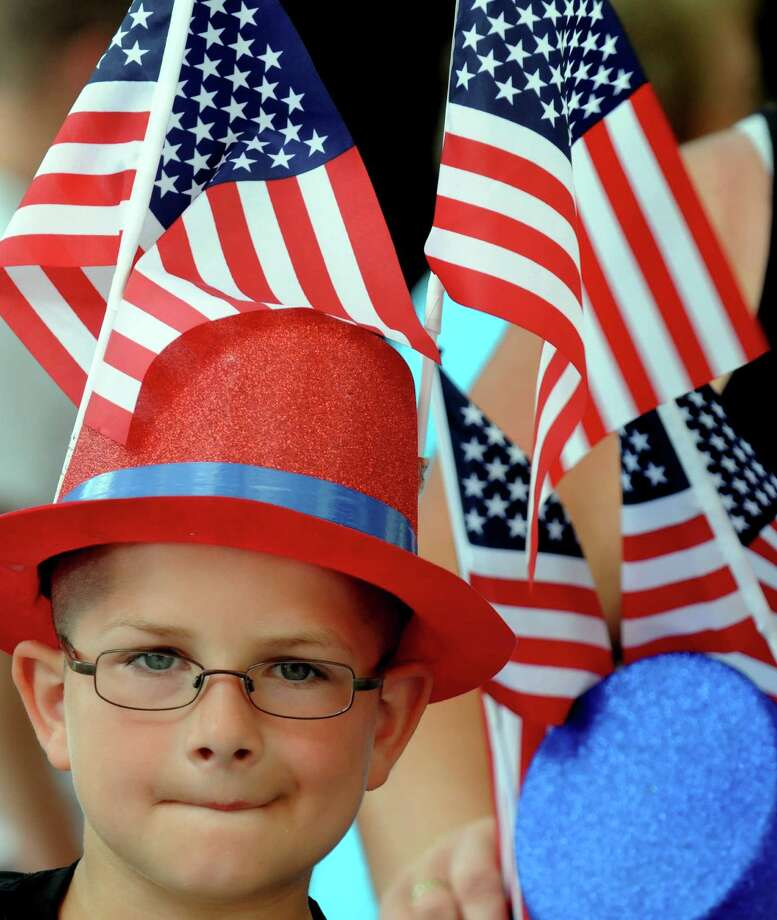 Cooper Willson, 8-years-old, of Malta watches the Saratoga Springs 4th of Jully Parade on Thursday July 4, 2013 in Saratoga Springs, N.Y. (Michael P. Farrell/Times Union) Photo: Michael P. Farrell / 00023042A