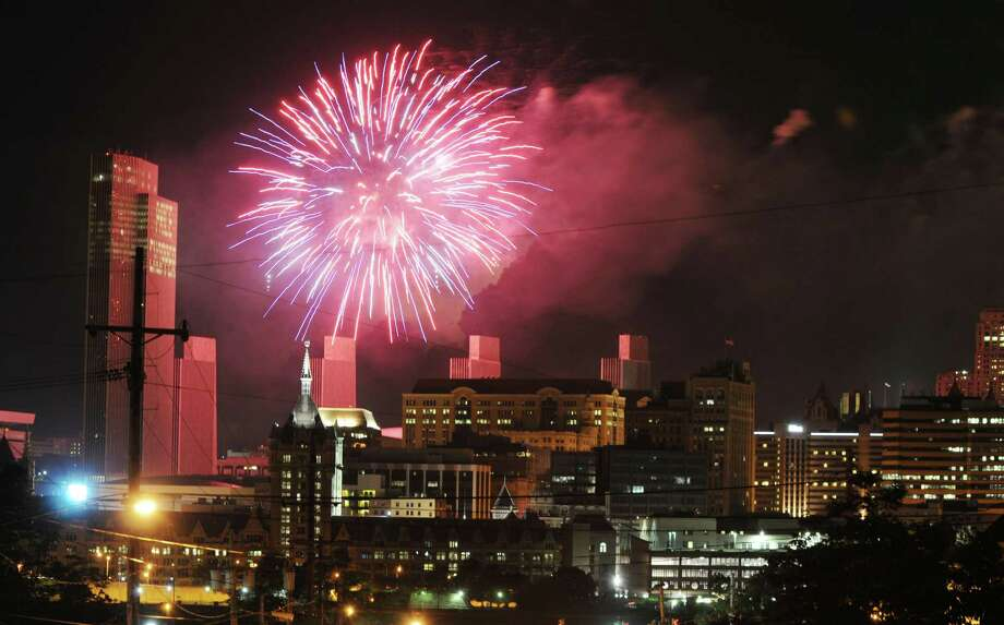 Fireworks light up the sky over Albany Thursday afternoon, July 4, 2013, during New York State's 4th of July Celebration Presented By Price Chopper at the Empire State Plaza. Photo taken from Rensselaer, N.Y. (Will Waldron/Times Union) Photo: WILL WALDRON / 00023016A