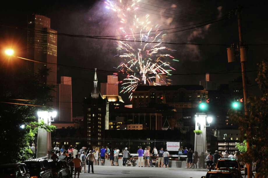 Fireworks light up the sky over Albany Thursday, July 4, 2013, during New York State's 4th of July Celebration Presented By Price Chopper at the Empire State Plaza. People came out onto the streets in Rensselaer, N.Y. to view the colorful Fourth of July display. (Will Waldron/Times Union) Photo: WILL WALDRON / 00023016A