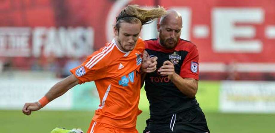 The Scorpions' Hans Denissen (right), battling Carolina's Paul Hamilton, scored twice in a victory at Toyota Field.