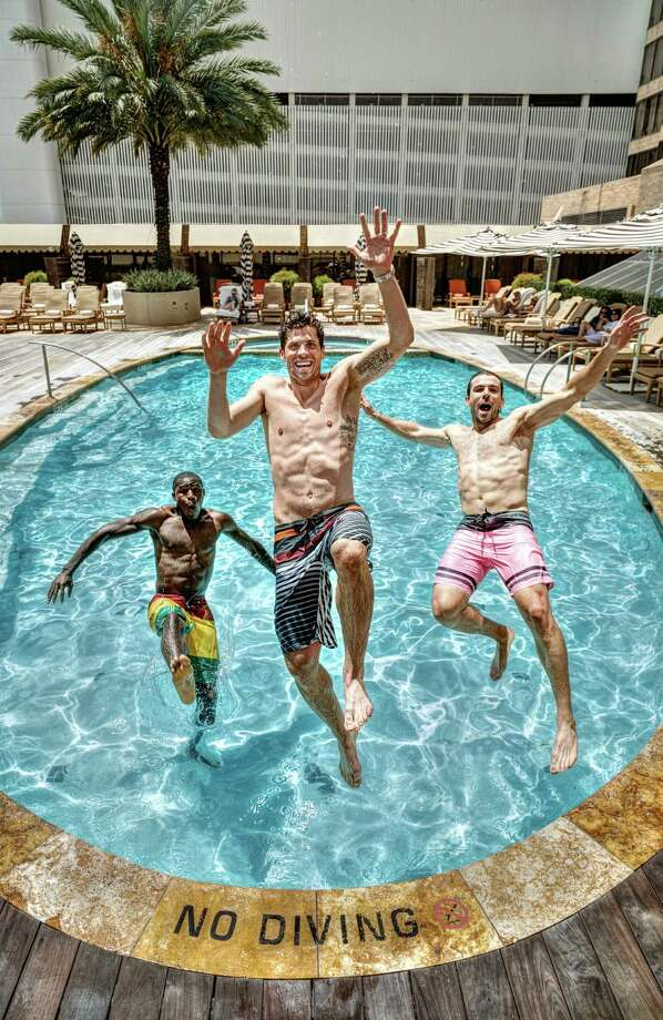 Houston Dynamo soccer players Kofie Sarkodie, left to right,Tally Hall  and Mike Chabala model men's swimwear at the Four Seasons Hotel Houston, Monday, June 24, 2013, in Houston. Photo: Michael Paulsen, Houston Chronicle / © 2013 Houston Chronicle