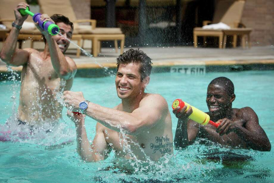 Houston Dynamo soccer players Mike Chabala, left to right, Tally Hall and Kofie Sarkodie model men's swimwear at the Four Seasons Hotel Houston, Monday, June 24, 2013, in Houston. Photo: Michael Paulsen, Houston Chronicle / © 2013 Houston Chronicle