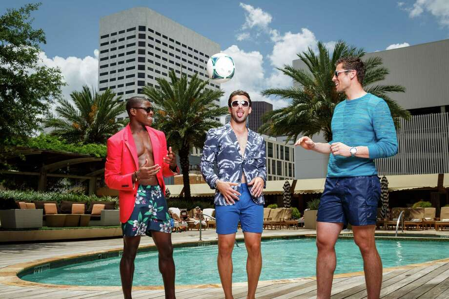 Houston Dynamo soccer players Kofie Sarkodie, left to right, Mike Chabala and Tally Hall model men's swimwear at the Four Seasons Hotel Houston, Monday, June 24, 2013, in Houston. Photo: Michael Paulsen, Houston Chronicle / © 2013 Houston Chronicle