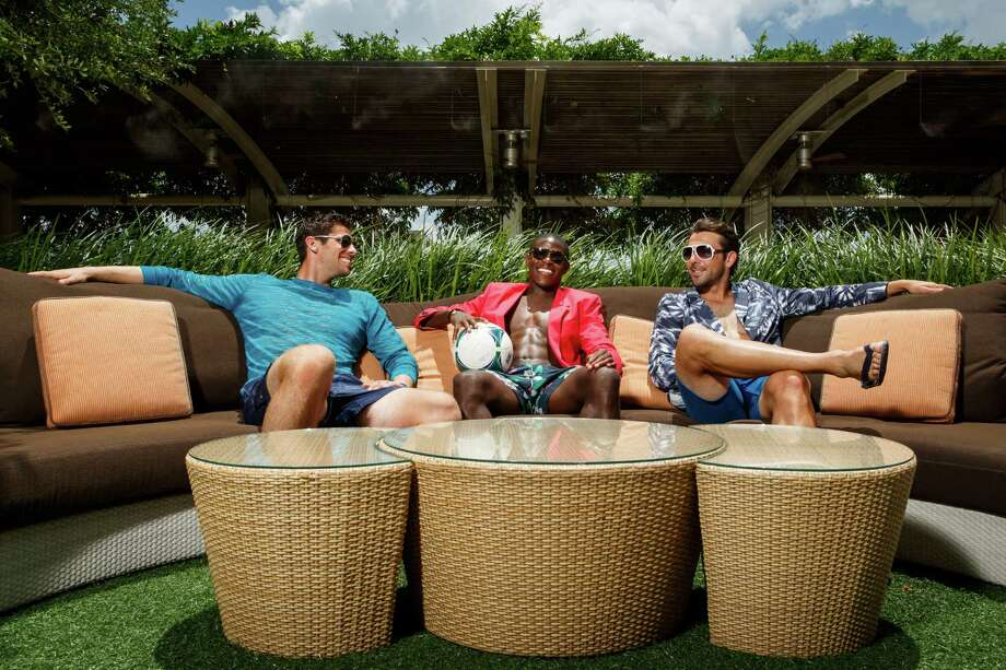 Houston Dynamo soccer players, Tally Hall, Kofie Sarkodie and Mike Chabala model men's swimwear at the Four Seasons Hotel Houston, Monday, June 24, 2013, in Houston. Photo: Michael Paulsen, Houston Chronicle / © 2013 Houston Chronicle