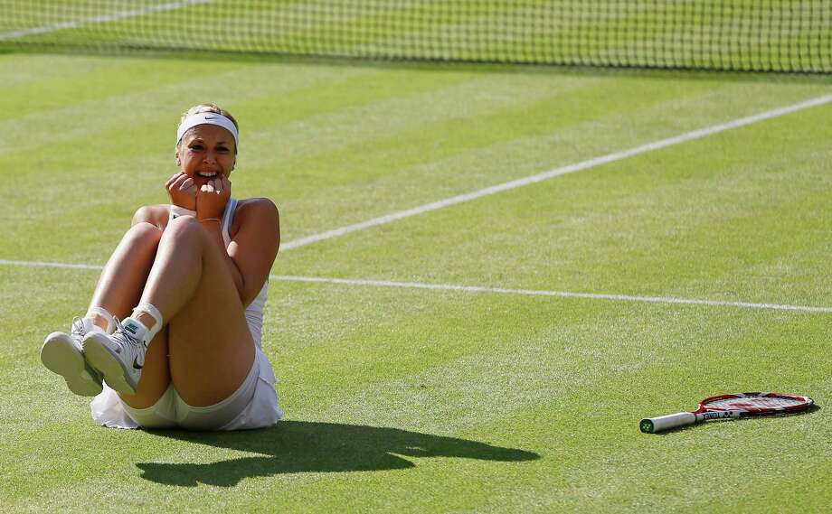 Sabine Lisicki of Germany reacts after defeating Agnieszka Radwanska of Poland in their Women's singles semifinal match at the All England Lawn Tennis Championships in Wimbledon, London, Thursday, July 4, 2013. (AP Photo/Kirsty Wigglesworth)  ORG XMIT: WIM334 Photo: Kirsty Wigglesworth, AP / AP