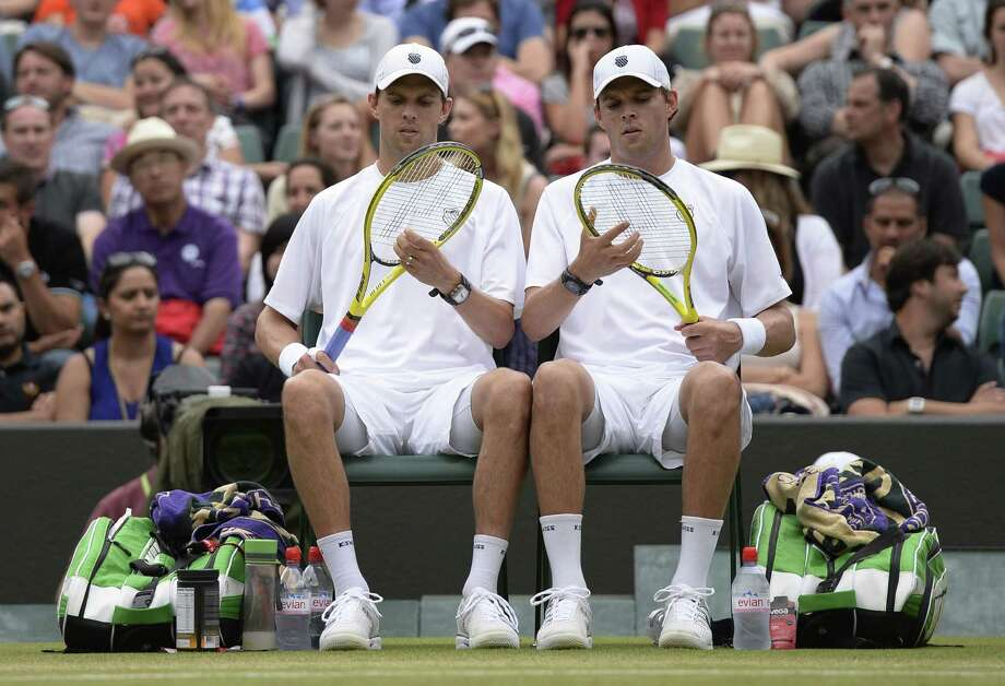 TOPSHOTS US players Bob Bryan (R) and Mike Bryan (L) sit between games against India's Rohan Bopanna and France's Edouard Roger-Vasselin in their men's doubles semi-final match on day ten of the 2013 Wimbledon Championships tennis tournament at the All England Club in Wimbledon, southwest London, on July 4, 2013. AFP PHOTO / ADRIAN DENNIS  -  RESTRICTED TO EDITORIAL USEADRIAN DENNIS/AFP/Getty Images ORG XMIT: 3441 Photo: ADRIAN DENNIS, Getty / AFP